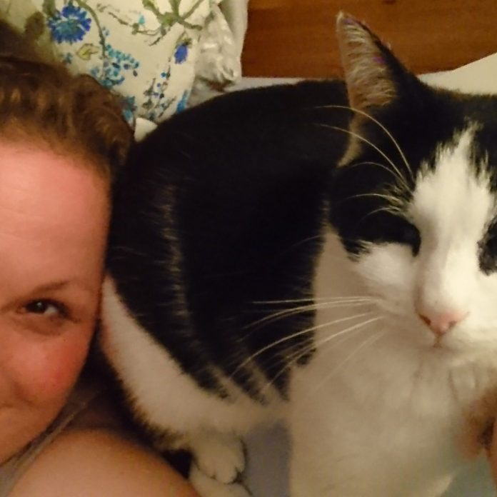 In bed with the cat